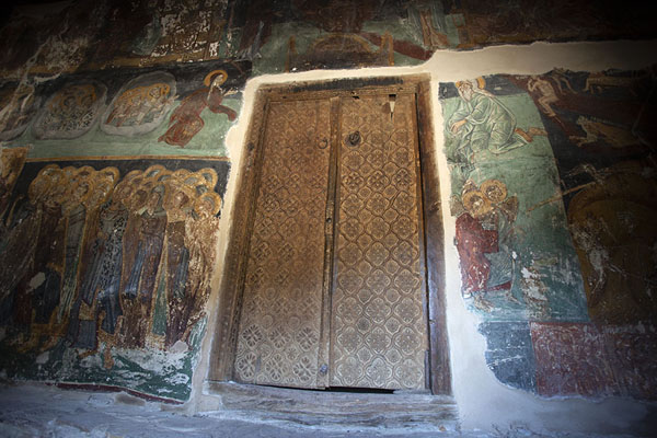 The old wooden door of Panagia church in Moutoulas with frescoes on the wall | Painted churches Troodos region | Cyprus