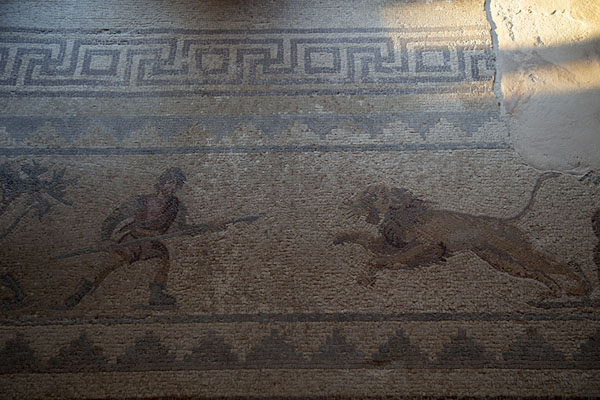 Foto van Hunter and lion depicted in a mosaic in the House of DionysosPafos - Cyprus