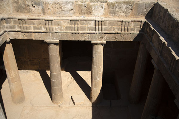 The atrium of Tomb III seen from above, with Doric columns and triglyhps | Tombs des Rois | Chypre