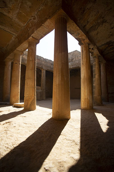 The atrium of Tomb III has columns all around | Tombs of the Kings | Cyprus