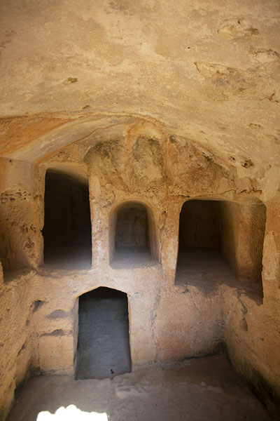 Several tombs carved out in the rock at Tomb IV | Tombs of the Kings | Cyprus