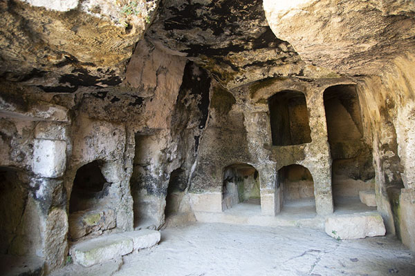 Tombs carved out in the rocks at Tomb IX | Tombs of the Kings | Cyprus