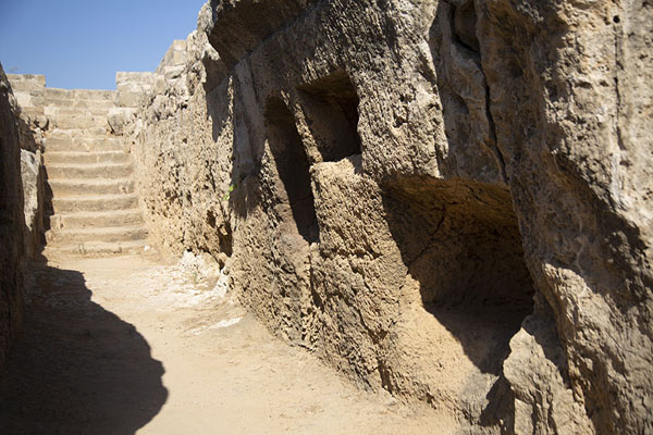 The corridor of Tomb VII with loculi and ossuaries carved out in the wall | Tombs des Rois | Chypre