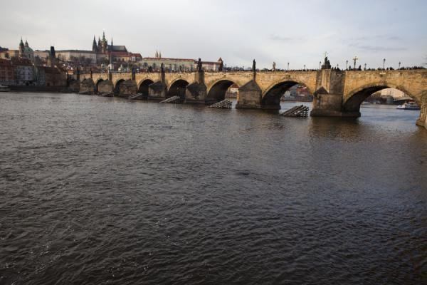 Picture of View of Charles Bridge with Prague Castle in the background from the southern side of the bridge in the Old Town