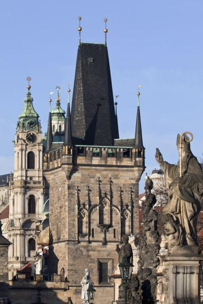 Malá Strana side bridge tower on Charles Bridge with statue of St. Augustine in the foreground | Charles Bridge | Czech Republic