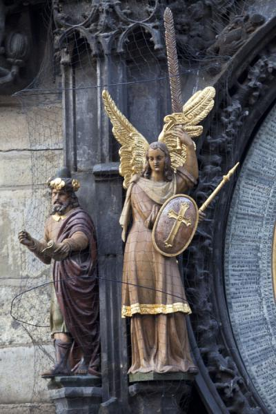 The Chronicler and Angel, standing next to the calendar at the lower end of the Astronomical Clock | Prague Astronomical Clock | Czech Republic