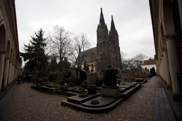 Picture of Looking at Vyšehrad cemetery from a corner of the two arcades, with the church of SS Peter and Paul in the background