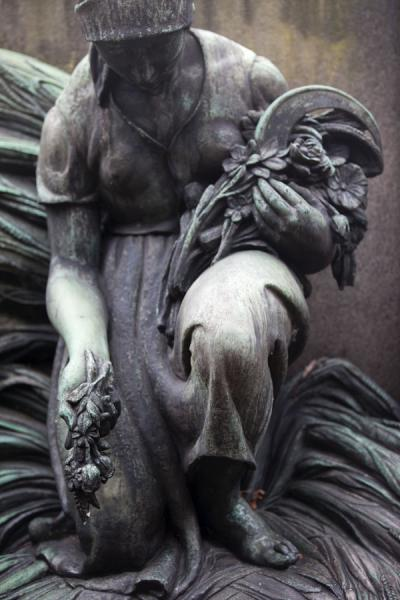 Picture of Vyšehrad cemetery (Czech Republic): Sculpture of woman kneeling on a tomb in Vyšehrad cemetery