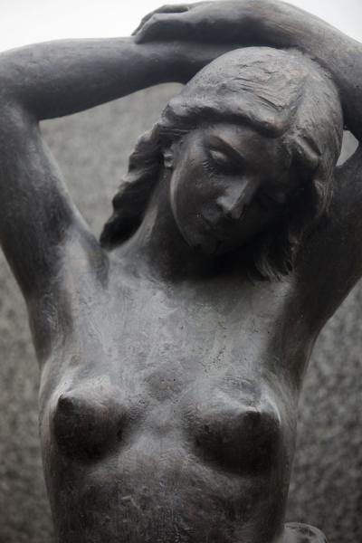 Picture of Vyšehrad cemetery (Czech Republic): Delicate statue of nude woman in Vyšehrad cemetery