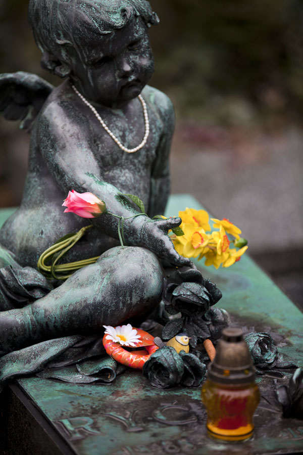 Picture of Sculpture of child with flowers on a tomb in Vyšehrad cemeteryPrague - Czechia