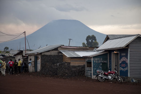 Nyiragongo volcano with smoke towering above a street in Goma | Goma | Rep. Democratica del Congo