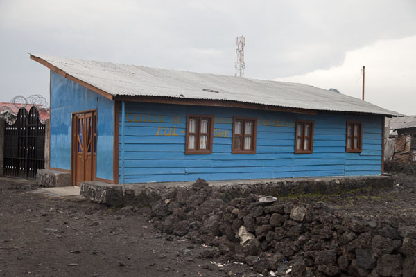 Picture of One of the many small wooden churches surrounded by volcanic rocks in Goma - Democratic Republic Congo - Africa