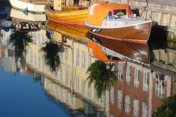 Houses and boats reflected in a canal | Copenhagen Waterfront | Denmark