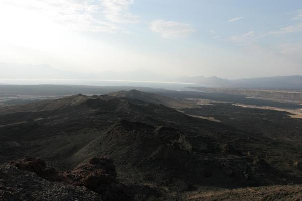 View from Ardoukoba Volcano: black lavafields, Lac Assal and mountains | Ardoukoba Volcano | Djibouti