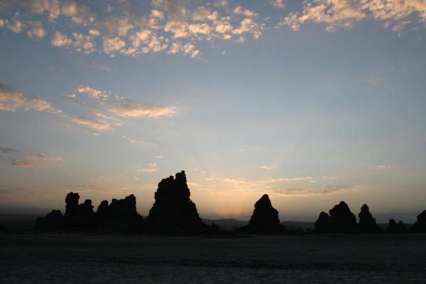Picture of Chimneys of Lac Abbé appearing from darkness at sunrise - Djibouti - Africa