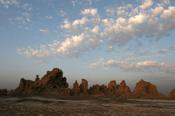 Chimneys and clouds of Lac Abbé appearing after sunrise | Lac Abbé | Djibouti