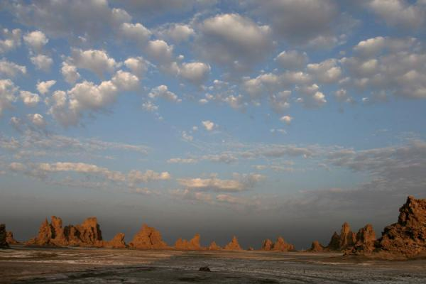 Picture of Chimneys at the horizon, clouds on the ceiling: Lac Abbé landscape - Djibouti - Africa