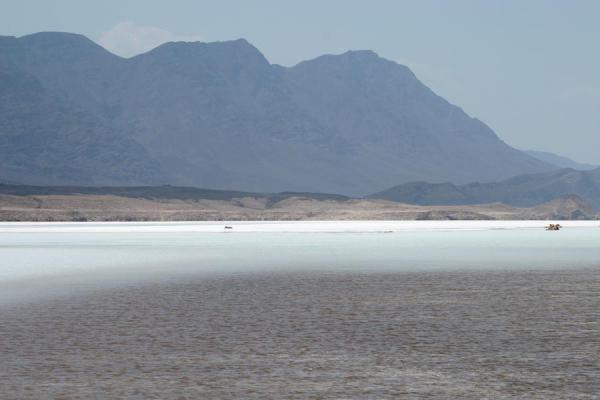 Salty water and solid salt in the background: landscape of Lac Assal | Lago Assal | Yibuti