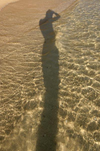 Shadow of the photographer in the transparent waters of Sable blanc | Sable Blanc | Djibouti