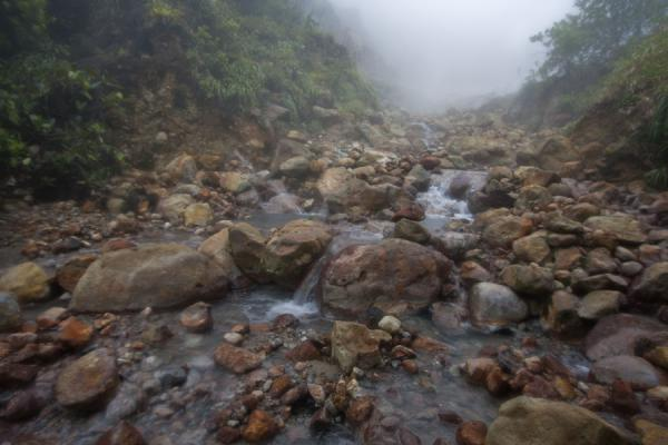 Foto van River with rocks and warm water running from the Valley of DesolationBoiling Lake - Dominica