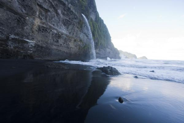 Ravine Cyrique waterfall and reflection in the sea and black sand | Ravine Cyrique waterfall | Dominica