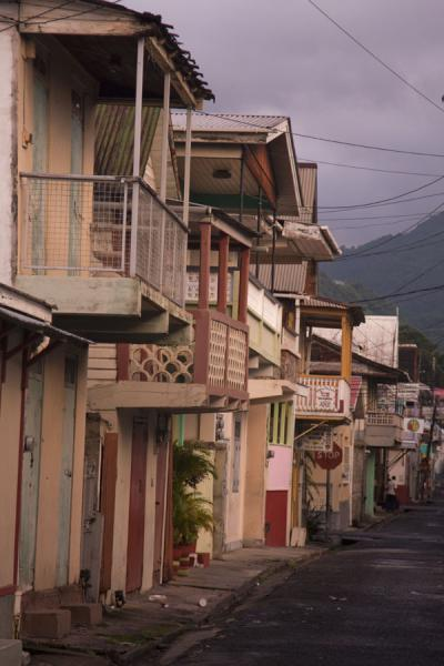 Picture of Narrow street in Roseau with a row of traditional houses