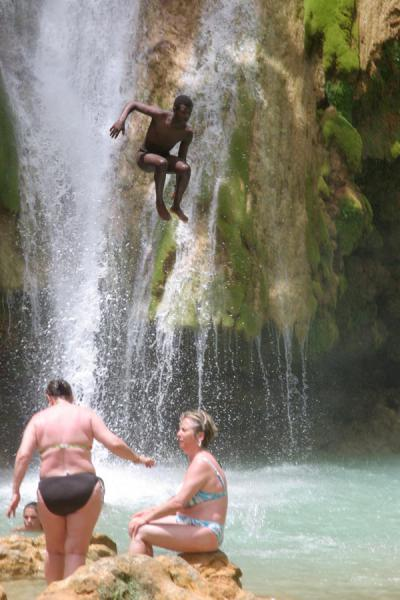Suspended in air: Dominican flying down just before hitting the water | Limón waterfall | Dominican Republic