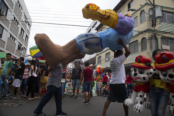 Foto di Two men carrying an effigy doll off the marketGuayaquil - Ecuador