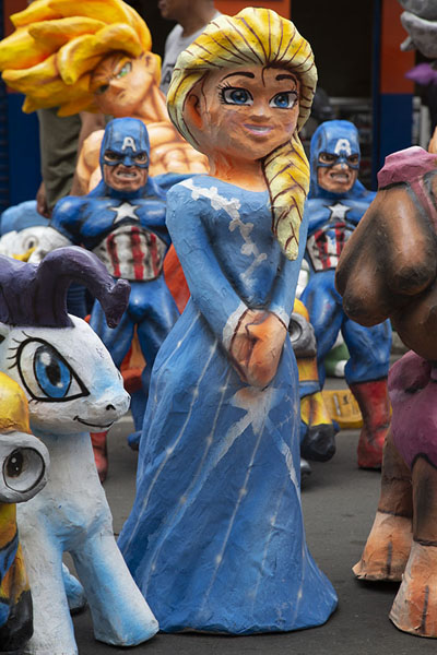 A wide collection of Año Viejo dolls on the street | Año viejo effigy dolls | Ecuador
