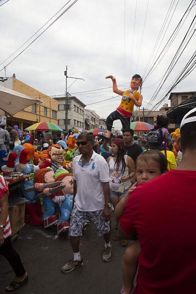 Picture of People roaming 6 de marzo street looking for Año Viejo dolls - Ecuador - Americas