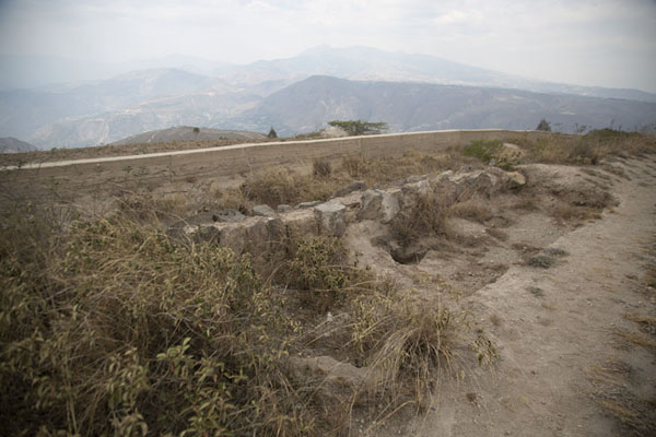 Photo de Wall with some of the archeological digs on top of Cerro CatequillaCatequilla - l'Equateur