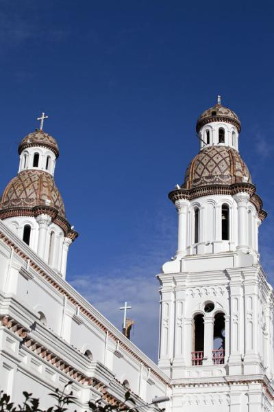 Picture of Cuenca old city (Ecuador): Richly decorated roofs of the bell towers of Santo Domingo church in Cuenca