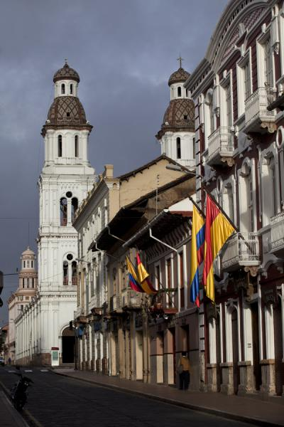 Picture of Cuenca old city (Ecuador): Santo Domingo bell towers seen from a street in Cuenca
