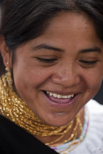Picture of Otavalo market women (Ecuador): Cheerful girl at the market of Otavalo
