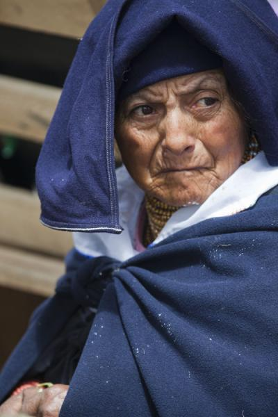 Picture of Otavalo market women (Ecuador): Woman with a worried look at the market of Otavalo