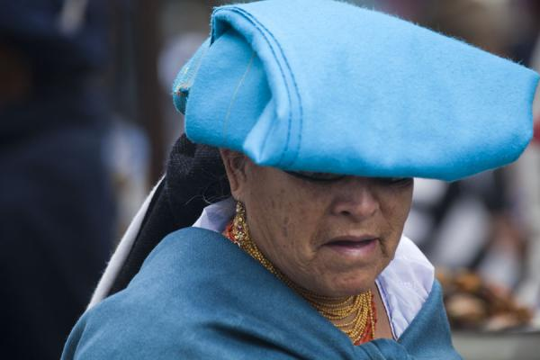 Picture of Otavalo market women (Ecuador): Bright blue cloth covering the head of this woman at the market of Otavalo