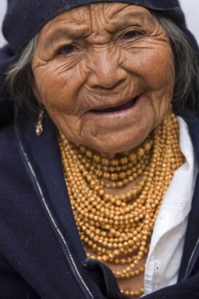 Picture of Otavalo market women (Ecuador): Old woman looking into the camera at Otavalo market