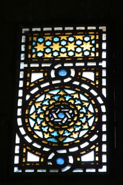 Foto van Coloured stained glass window in ar-Rifai mosqueCairo - Egypte