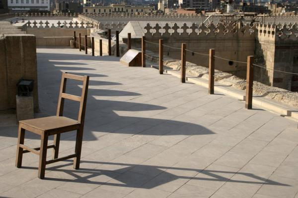 On the roof of Bab Zuweyla, chair and shadows | Bab Zuweyla | Egypt