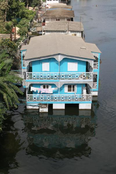 Blue and white houseboat on the river Nile | Houseboats | Egypt