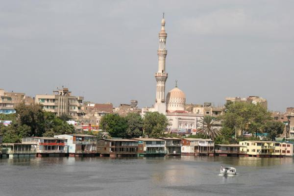 Picture of Kit Kat mosque towering above the houseboats in the river Nile