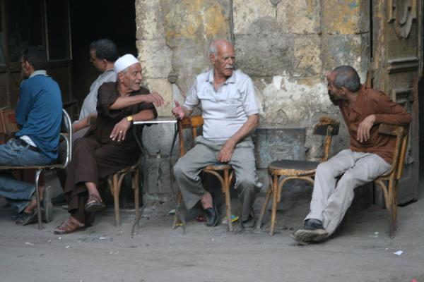 Men having a chat on a street corner | Darb al-Ahmar street scenes | Egypt