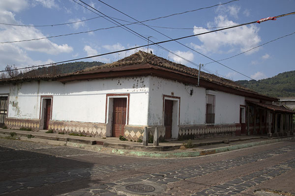 Picture of White house on the corner of a cobble-stone street in ApanecaApaneca - El Salvador