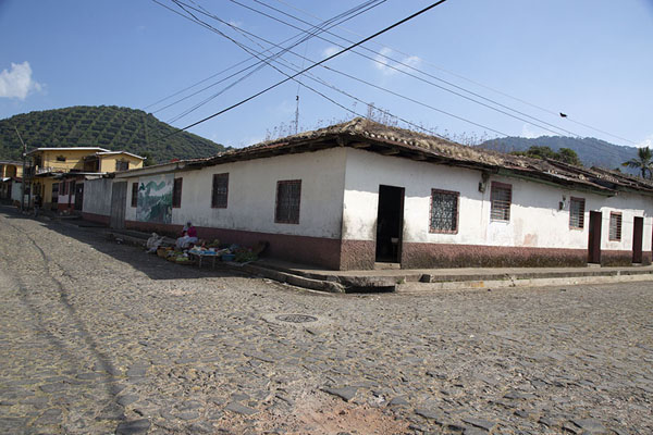 Cobble-stone streets of Apaneca with coffee plantations on surrounding moutains | Apaneca | El Salvador