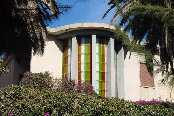 Foto di Use of coloured glass is another feature of some modern buildings in AsmaraAsmara - Eritrea