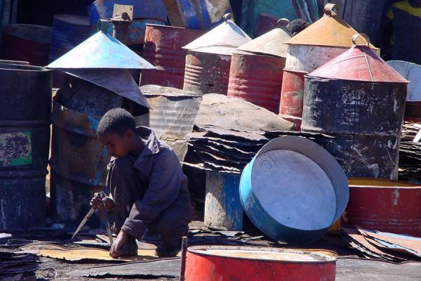 Young boy working on recycling oil drums at Medebar market in Asmara | Eritrean Markets | Eritrea