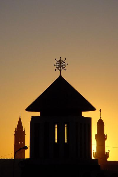 The belltower of the Cathedral, the minaret of the mosque, and one of the towers of the Orthodox church together | Eritrean Religions | Eritrea
