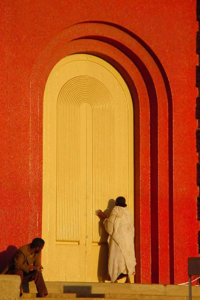 Praying in front of the women's door of the Orthodox Church in Asmara | Eritrean Religions | Eritrea