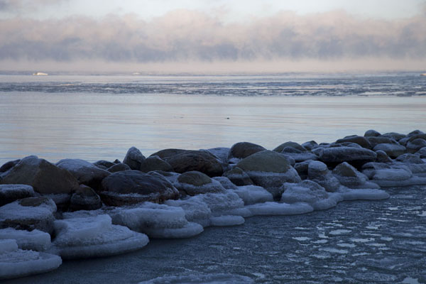 Picture of Estonian Open Air Museum (Estonia): Ice floating on the waters of Kopli Bay with a pier of stone boulders