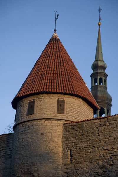 Defence tower and spire of church in the background | Old Tallinn | Estonia